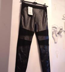 hlače sa kožnim detaljima L XL