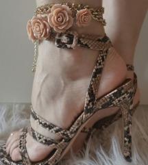 Reserved sandale zmijski uzorak nove