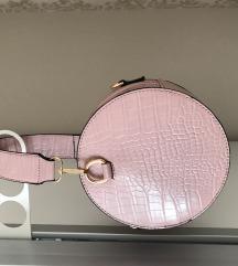 Okrugla baby roza torbica