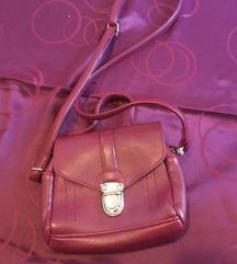mala torbica boje vina kao nova