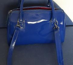 Prodajem tamnoplavu torbicu