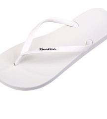 Bijele ipanema japanke s etiketom