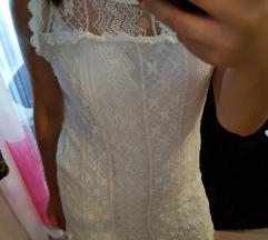 Bijela cipkasta haljina