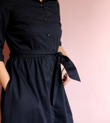 crna haljina na kopčanje