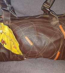 dizajnerska kožna arka torba