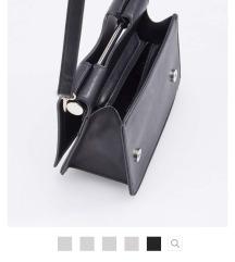 Nova Reserved crna torbica s remenom