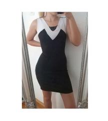 Elegantna crna haljina sa bijelim detaljima