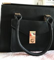 Crna torba sa zlatnim detaljima