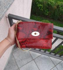 Ne korištena torbica