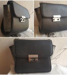 Crna torbica sa srebrenim detaljima