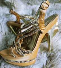 Štikle zlatne boje