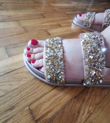 Sandale sa zlatnim šljokicama