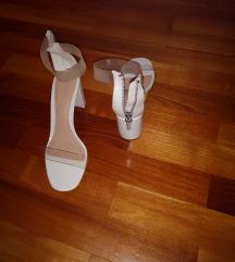 Bijele sandale na petu sa prozirnim remenima