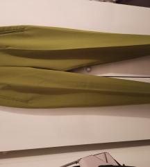 Zelene hlače mrkva kroja na crtu