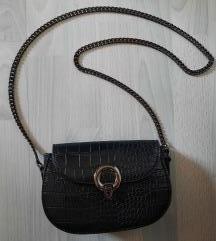 Mala crna torbica, pt uključena