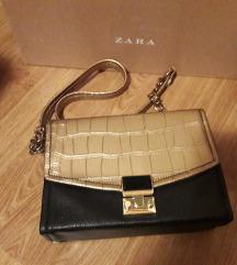 Novo zlatno-crna torbica