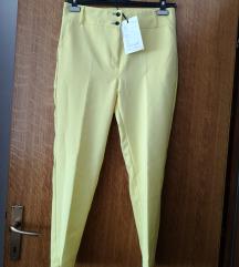 Jarko žute svečane hlače na crtu