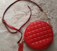 Okrugla crvena torbica