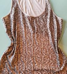 Majica, dvije haljine i dvije suknje 46/