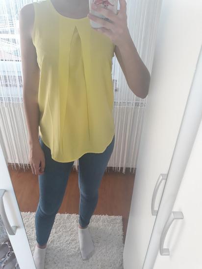 Žuta bluza bez rukava