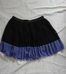 Leprsava mini suknja velicine 38