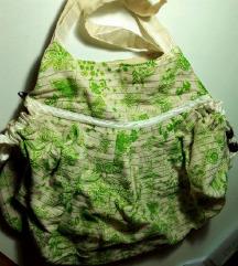 Zelena platnena torba sa zlatnim nitima
