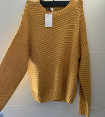 Zuti H&M pulover s etiketom