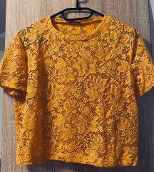 21.  Zara žuta crop lace majica
