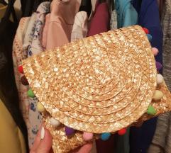 Ljetna pletena torbica s pomponima