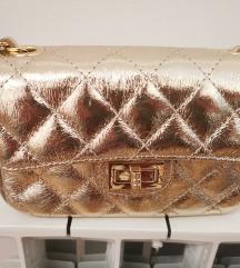 Zlatna mala torbica kožna