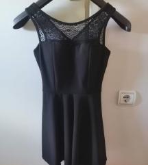 Crna haljina s mašnom