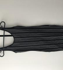 Uska crna haljina nikad nosena