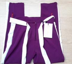 nove hlače boja fuksije ( ljubičaste)