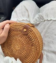 Mala okrugla pletena torba