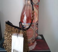 Zara mala torbica s etiketom