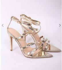 Zlatne sandale na petu