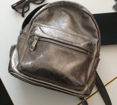 Zlatni kožni ruksak