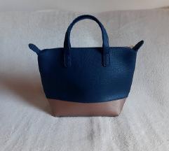 Nenosena plavo/broncana torbica