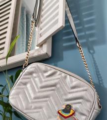 Siva torbica s golubom