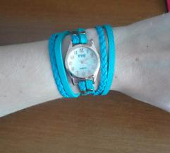 Tirkizni sat koji se nosi na drugačiji način